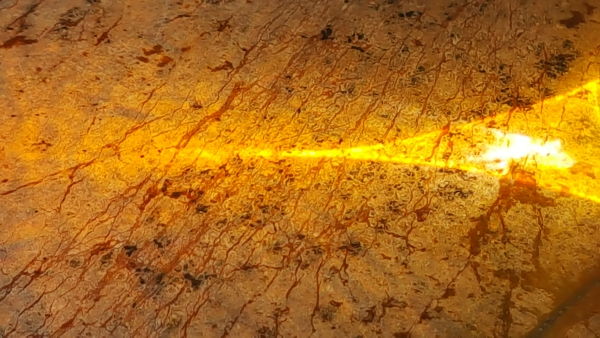 gold mineral with a bit of light shining on it